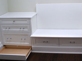 Banquette seating with concealed drawers in kick