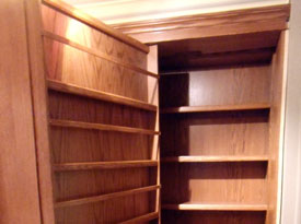 Pivoting concealed oak bookcase