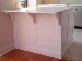 Traditional kitchen island with brackets
