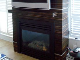 Contemporary ebony mantle with aluminum reveals