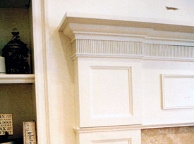 Traditional painted fireplace with dentils