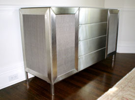 Stainless steel console with mesh panels