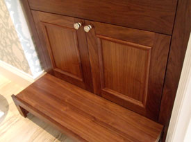 Walnut vanity with pull-out foot stool